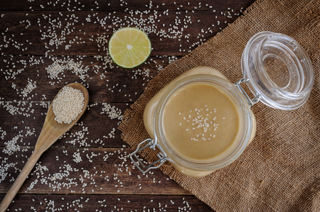 butter: Fresh homemade Tahini (sesame paste) in a glass jar Stock Photo