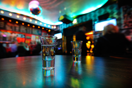 nightclub: Tequila in shot glasses on the table in a nightclub. Selective Focus