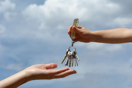 childs hand with keys photo