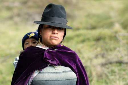 femal: the latin woman in national clothes with little child. ecuador. south america