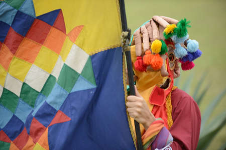solstice: Man in mask celebrating solstice holiday in Latin America.
