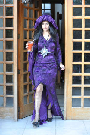 bewitch: Woman in Halloween costume.