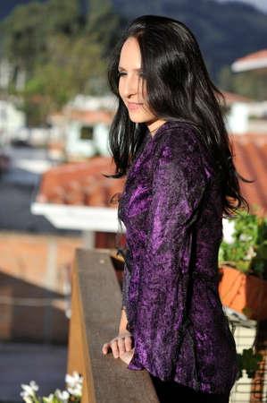 purple dress: Woman dressed in purple dress. Stock Photo