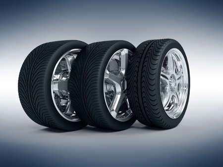 Car wheels with steel rims over the blue background