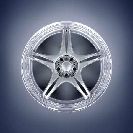 Car alloy rim on blue background Stock Photo - 4544252