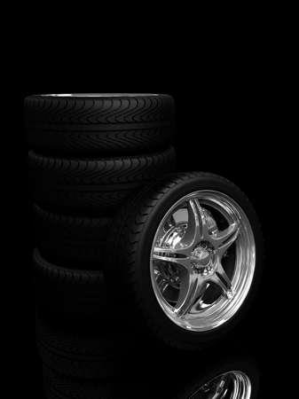 tire tracks: ruedas de coche con llantas de acero sobre el fondo negro