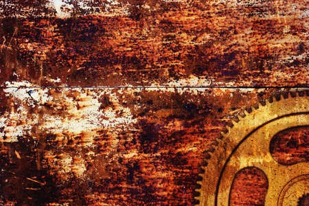 Grunge gear on rusty metal background photo