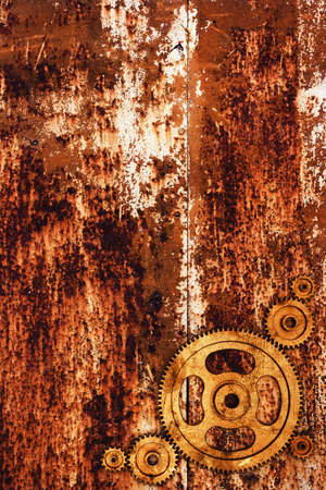 Grunge gears on rusty metal background photo