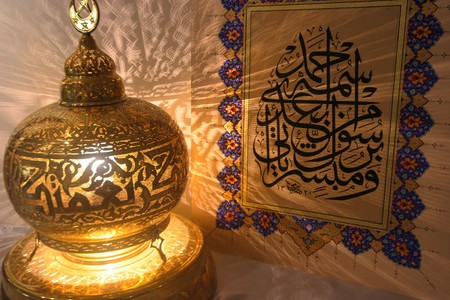islamic decoration of a lamp and an artistic arabic calligraphy