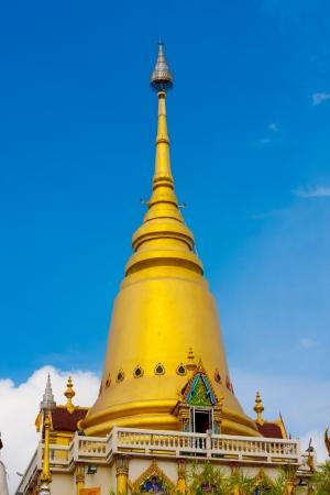 Golden pagoda against sky