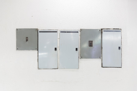 electric box on white wall Stock Photo