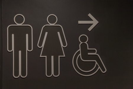symbol graphic men, women and Disabled on black background Stock Photo