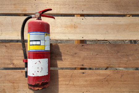 Old fire extinguisher on plank