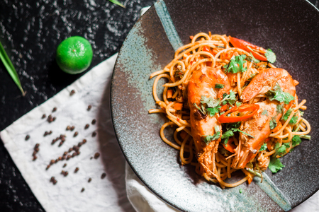 Spaghetti Tom Yum Goong, a fusion of Italian food.
