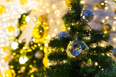christmas trees are decorated with beautiful objects and have bokeh from light bulb on big christmas
