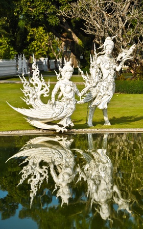 Native Thai style angel statue in Wat Rong Khun, Chiang Rai province, northern Thailand  Stock Photo