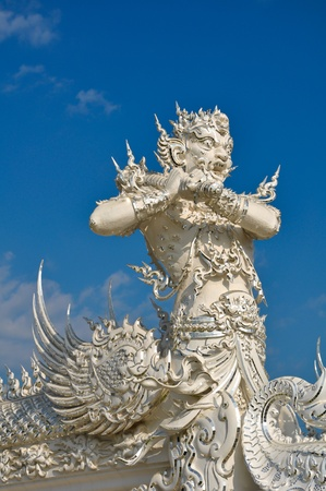 Native Thai style giant statue in  Wat Rong Khun, Chiang Rai province, northern Thailand  Stock Photo