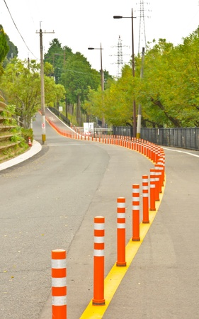 Empty road with traffic barrier in Isahaya, Japan Stock Photo - 9913182