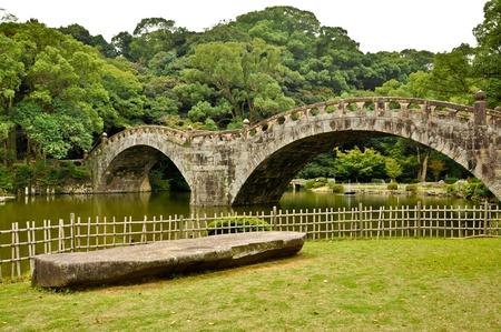 stone bridge in japanese garden at isahaya japan stock photo 10003930