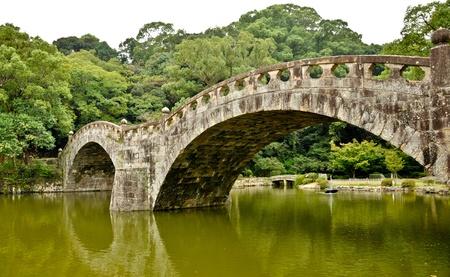 Stone bridge in Japanese garden at Isahaya, Japan Stock Photo - 10003929