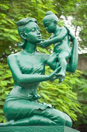 Mother and son in the traditional Thai style dress statue  at Publick Park in Bangkok, Thailand photo
