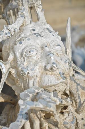 Scary sculpture at  Rong Khun Temple, Chiang Rai, Thailand Stock Photo - 10279677