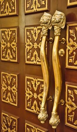 Golden lion handle photo
