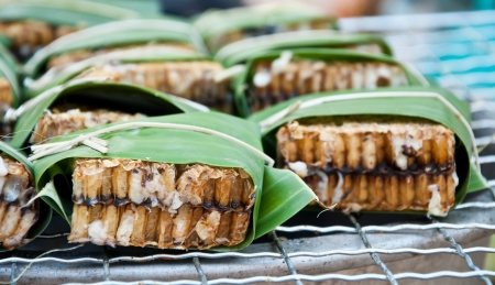 Grilled bee wrap with banana leaf at border of Thailand-Laos Stock Photo - 14391511