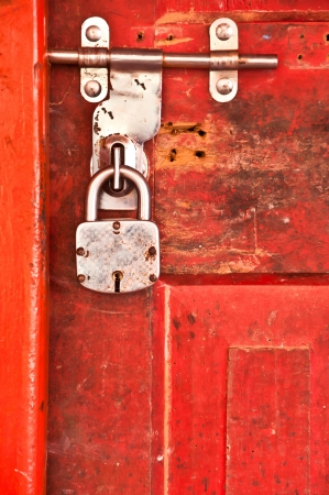 Old Lock with red locked door Stock Photo