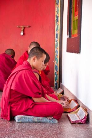 Tibetian lama is praying  at Ramtek Monastery in Gungtok, Sikkim, India