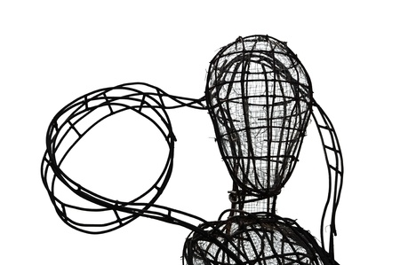 Unfinished sculpture with iron and wire on white background