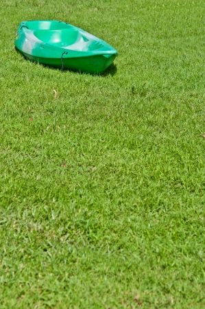 green boat: The green boat on the grass as background