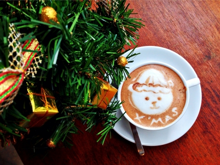 The coffee art with christmas tree on the wooden table