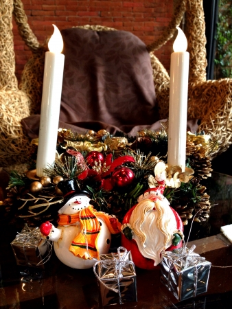 weave: The santa clause and snowman with christmas item in living room