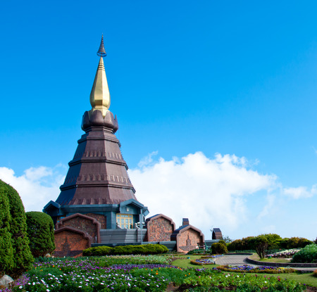 The modern thai style pagoda with blue sky and garden name Phra Maha Dhatu Nabha Metaneedol pangoda in Chiang Mai, Thailand photo
