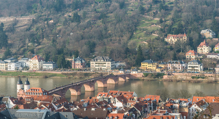 west gate: The cityscape of Heidelberg city with the old bridge cross the River Neckar and West gate tower in Heidelberg, Germany