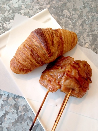 grill: A croissant with grill pork on the white plate Stock Photo
