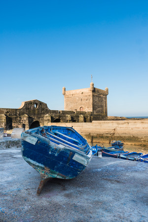 onshore: A blue boat park on onshore of Skala du Port in Essaouira, Morocco