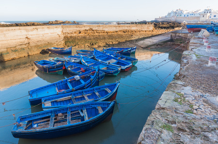 skala: The blue boats park at of Skala du Port in Essaouira, Morocco Stock Photo