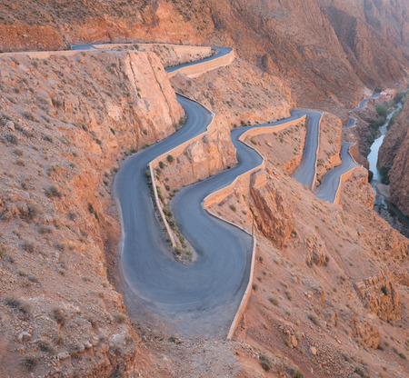 The zigzag road to Gorges du Dades valley during end of winter and beginning of spring on March 2014 in Gorges du Dades or Dadès Gorges city which located in Morocco