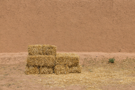 made in morocco: The haystack in front of dried  wall made of soil and straw as afican traditional in Morocco for background