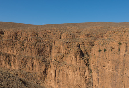 gorges: The cliff of mountain on the way to Gorges du Dades valley which is sedimentary rock during end of winter and beginning of spring on March 2014 in Gorges du Dades or Dadès Gorges city which located in Morocco Stock Photo