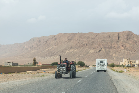 recreational vehicle: Midelt Morocco  Mar 18: The farmar rides truck by in opposite directions with recreational vehicle of tourist on March 18 2014 in Midelt Morocco