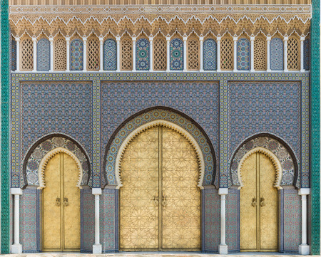 Bab Dar Lmakhzen or the Royal Palace Gate erected in the 1960's, as the surrounding wall of the royal palace in Fes, Morocco. The gate is characterized by its seven symmetrically arranged doors and windows with rich and varied ornamentation covered by g