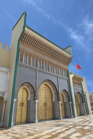 fez: Bab Dar Lmakhzen or the Royal Palace Gate erected in the 1960's, as the surrounding wall of the royal palace in Fes, Morocco. The gate is characterized by its seven symmetrically arranged doors and windows with rich and varied ornamentation covered by g