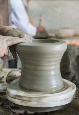 circulated: The artist mold the pottery on the circulated plate in pottery factory name Serghini Maitre Potier et Zellige Fassi in Fes, Morocco Stock Photo