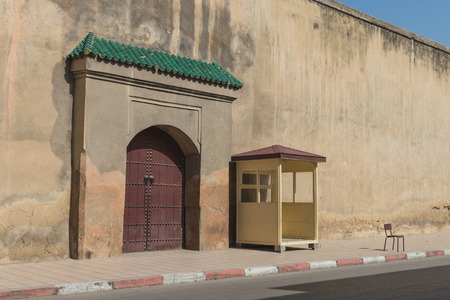 fes: The guradhouse near  old gate with wooden door in Fes, Morocco Stock Photo