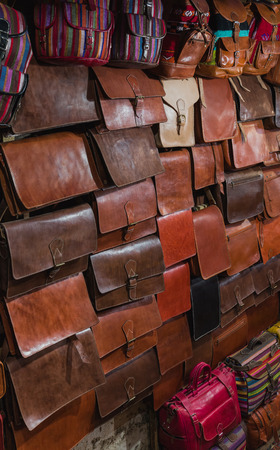 made in morocco: The traditional bag of Morocco made from leather as isolated picture Stock Photo