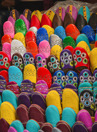 made in morocco: The colorful traditional shoes of Morocco made from leather sell in the Medina in Fes, Morocco