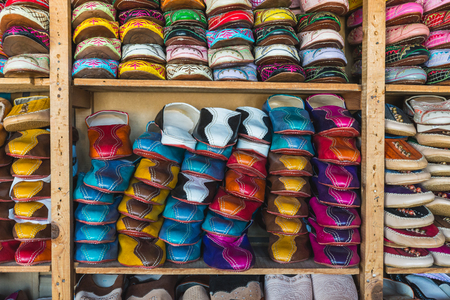 fes: The colorful traditional shoes of Morocco made from leather sell in the Medina in Fes, Morocco